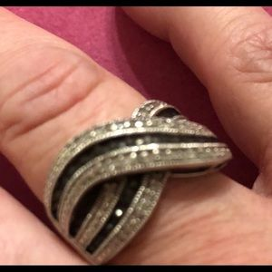 Black and white diamonds in silver ring